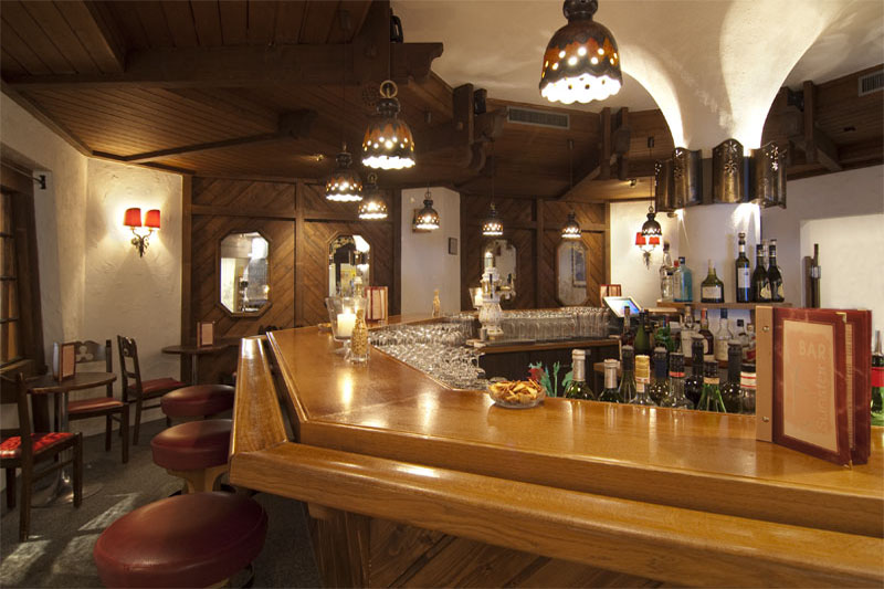 The well stocked bar is the perfect place for an after dinner drink